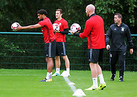 Ashley Williams (L) hold the ball for a team mate during the Wales Training Session at the Vale Resort, Hensol, Wales, UK. Tuesday 29 August 2017