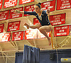 Miranda Lund of Plainview JFK performs on the balance beam during the eight-team Cartwheel for a Cure gymnastics meet at Cold Spring Harbor High School on Monday, Jan. 16, 2017.