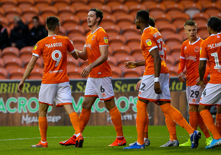 Blackpool's Ben Heneghan is congratulated after scoring the opening goal <br /> <br /> Photographer Alex Dodd/CameraSport<br /> <br /> EFL Leasing.com Trophy - Northern Section - Group G - Blackpool v Morecambe - Tuesday 3rd September 2019 - Bloomfield Road - Blackpool<br />  <br /> World Copyright © 2018 CameraSport. All rights reserved. 43 Linden Ave. Countesthorpe. Leicester. England. LE8 5PG - Tel: +44 (0) 116 277 4147 - admin@camerasport.com - www.camerasport.com