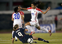 Heather O'Reilly (left) slide tackles Raquel Rodriguez of Costa Rica (right). USWNT vs Costa Rica in the 2010 CONCACAF Women's World Cup Qualifying tournament held at Estadio Quintana Roo in Cancun, Mexico on November 8th, 2010.