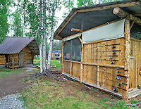 Fishing rods and cabins at Lake George, Alaska