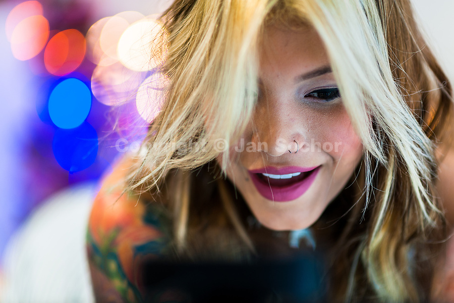 A Colombian cam model, known as Marcela Guzman, flirts with the online viewers during a webcam video broadcast from her apartment in Medellín, Colombia, 22 November 2016. With the traditional adoration of female beauty in Colombia, together with rapidly developing telecommunications technologies, the millennial generations of Colombian girls have turned the city of Medellín during the past few years into a one of the world centers of webcam modelling, a booming interractive sex industry. Thousands of young women stream everyday via websites that allow the global viewers to personally interract with a model and to pay them for sexually related acts. Although the core of the show is always based on stripping, the crucial part of a cam girl's success is communication. Cam models who have the ability of light conversation, flirting and entertaining the viewer earn thousands of dollars a month and have moved far beyond the borders of sexuality. Sharing their whole lives in a constant interaction with their online clients, they have built regular relationships in the cyberspace.