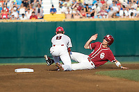 Oklahoma's Chris Ellison attempts to steal in Game 10 of the NCAA Division One Men's College World Series on June 24th, 2010 at Johnny Rosenblatt Stadium in Omaha, Nebraska.  (Photo by Andrew Woolley / Four Seam Images)