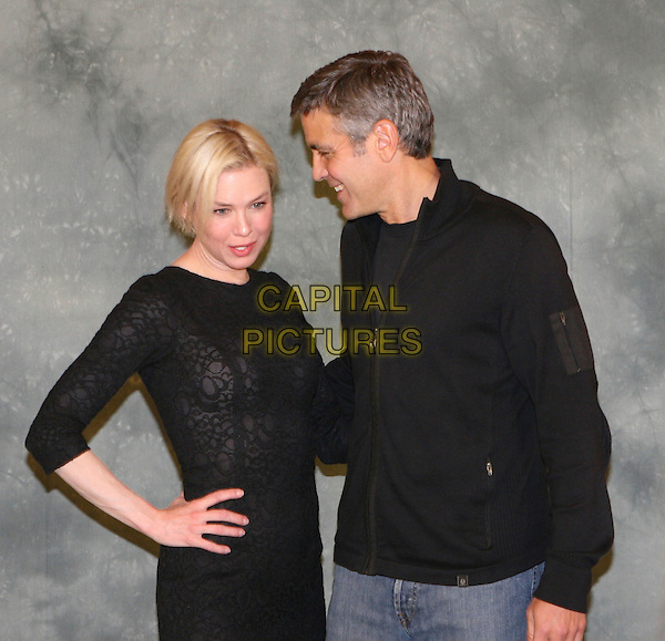 "RENEE ZELLWEGER & GEORGE CLOONEY .Photocall for film ""Leatherheads"" ( Italian - 'In amore niente regole"" ).in Rome, Italy, April 10th 2008..half length black hand on hip top shirt  zip-up top jacket sheer patterned .CAP/CAV.©Luca Cavalari/Capital Pictures"