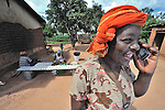 A woman uses a mobile phone in Zombwe, a rural village in Malawi.
