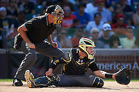 Umpire Mike Droll and catcher Cooper Johnson (25) of Carmel Catholic High School in Mundelein, Illinois during the Under Armour All-American Game on August 15, 2015 at Wrigley Field in Chicago, Illinois. (Mike Janes/Four Seam Images)