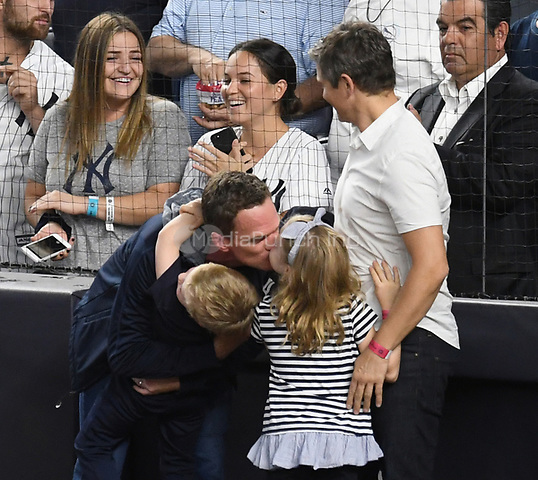 NEW YORK, NY - October 8 : Neil Patrick Harris, David Burtka and kids on field at Yankee Stadium during game 3 of the ALDS on October 8,2017 Bronx New York . @John Palmer / Media Punch