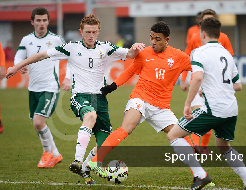 20150314 - GENDT , NETHERLANDS  : duel pictured between Dutch Donyell Malen (18) and Northern-Irish Shea Gordon (left) during the soccer match between Under 17 teams of  The Netherlands and Northern Ireland , on the second matchday in group 3 of the UEFA Elite Round Under 17 at De Bataven Stadion , Gendt , The Netherlands . Saturday  14 th March 2015 . PHOTO DAVID CATRY