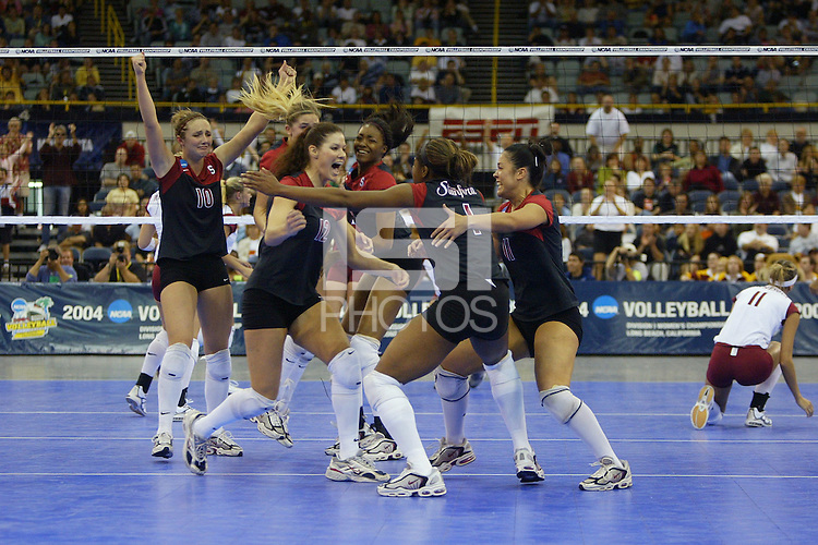 18 December 2004: The Stanford team celebrates match point during Stanford's  30-23, 30-27, 30-21 victory over Minnesota in the 2004 NCAA Women's Volleyball National Championships in Long Beach, CA. Stanford won their sixth women's volleyball title in school history. Pictured are Kristin Richards, Jennifer Hucke, Bryn Kehoe, Franci Girard, Ogonna Nnamani, and Leahi Hall.<br />