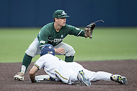 Michigan State Spartans second baseman Dan Durkin (9) waits for a pick off throw as Michigan Wolverines baserunner Jonathan Engelmann (2) slides back into the base on May 19, 2017 at Ray Fisher Stadium in Ann Arbor, Michigan. Michigan defeated Michigan State 11-6. (Andrew Woolley/Four Seam Images)