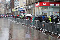 Sunday 3rd August 2014<br /> Pictured: Commonwealth Games Men's Road Race crowd<br /> RE: Commonwealth Games Men's Road Race crowd standing in the rain with umbrellas in front of barriers on Argyle Street, Glasgow, Scotland
