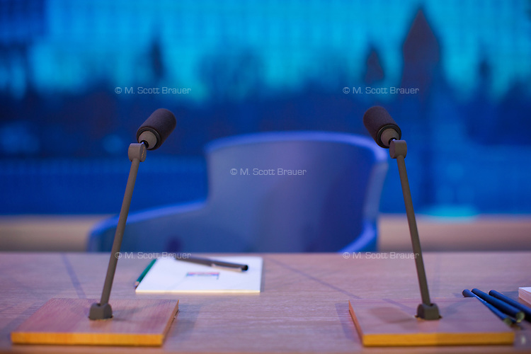 Microphones stand on a desk before Vladimir Putin begins his annual press conference in Moscow, Russia. The press conference lasted 5 hours.