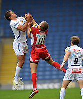 Oxford, England. Ignacio Mieres of Exeter Chiefs  and  Nick Scott of London Welsh go for a high ball during the Aviva Premiership match between London Welsh and Exeter Chiefs at the Kassam Stadium on September 16, 2012 in Oxford, England.