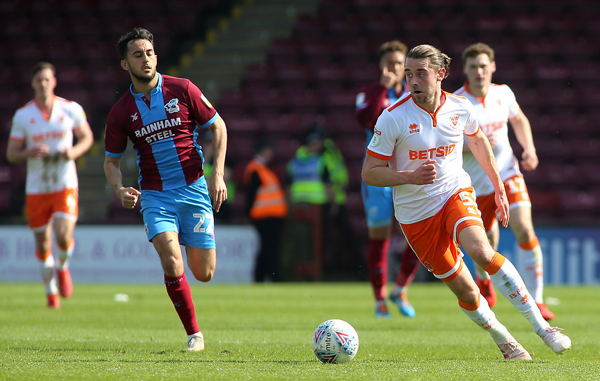 Blackpool's Antony Evans gets away from Scunthorpe United's Levi Sutton<br /> <br /> Photographer David Shipman/CameraSport<br /> <br /> The EFL Sky Bet League One - Scunthorpe United v Blackpool - Friday 19th April 2019 - Glanford Park - Scunthorpe<br /> <br /> World Copyright © 2019 CameraSport. All rights reserved. 43 Linden Ave. Countesthorpe. Leicester. England. LE8 5PG - Tel: +44 (0) 116 277 4147 - admin@camerasport.com - www.camerasport.com