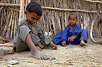 Boys play freely in their village outside Mirpurkhas, Pakistan. With help from the Lower Sindh River Development Association (LSRDA), their families are working their own fields, free of the landlords' control for the first time. LSRDA has worked throughout the area providing education, credit, and empowerment to vulnerable groups often living in virtual slavery to large landowners.