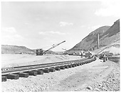 Construction of new loop in Durango yard.  Laying rails on southwest loop with a crane.<br /> D&amp;RGW  Durango, CO  Taken by Payne, Andy M. - 4/30/1968