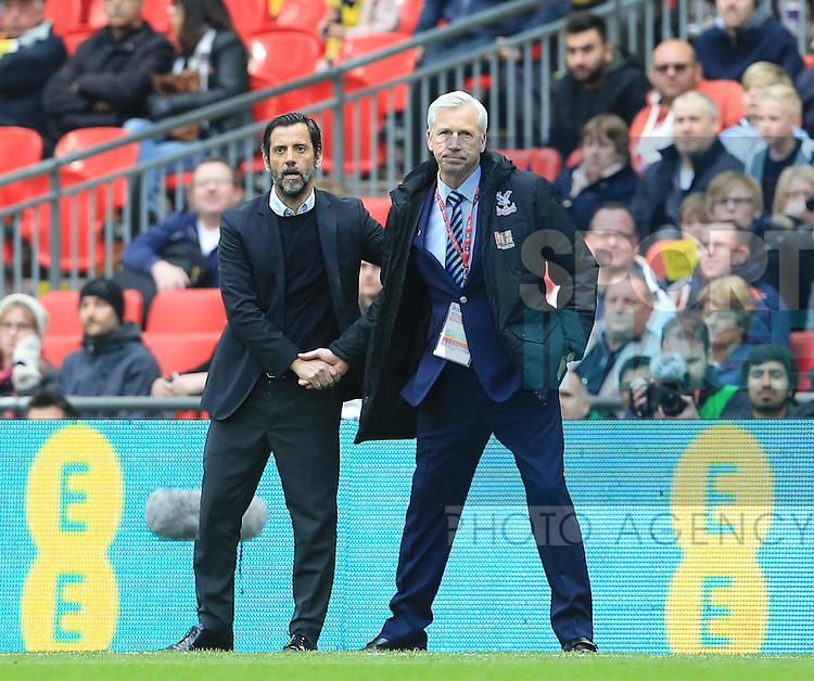 Crystal Palace's Alan Pardew shakes hands with Watford's Quique Flores at the final whistle during the Emirates FA Cup, Semi-Final match at Wembley Stadium, London.  Photo credit should read: David Klein/Sportimage
