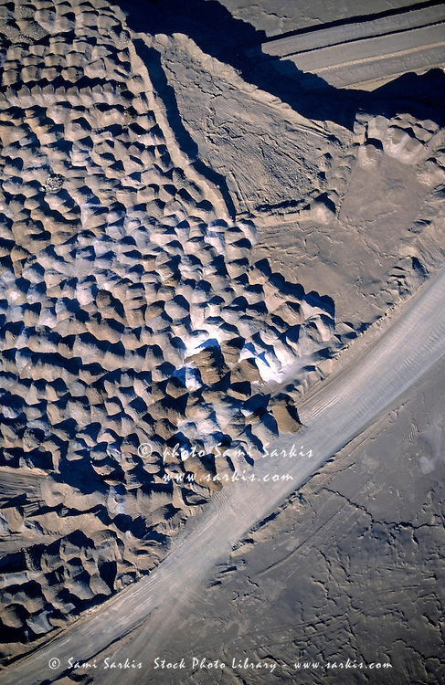 Patterns on the landscape from soil mining seen from above.