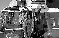 President Gerald Ford, Vice Presidential running mate Senator Robert Dole and Mrs. Elizabeth Dole debark Marine I to attend a Campaign Rally in the Senator's hometown, Russell, Kansas. 20 August 1976