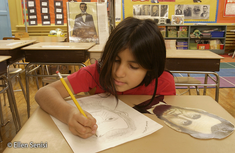 MR / Schenectady, NY.Yates Arts-in-Education Magnet Schl (urban elementary schl) Grade 4 girl (9, Puerto Rican-American) draws picture of Abraham Lincoln from photo as part of history unit on American Presidents. At this arts magnet school, hands-on activities utilizing the arts are intergrated with core curriculum requirements whenever possible..MR: Col6.©Ellen B. Senisi