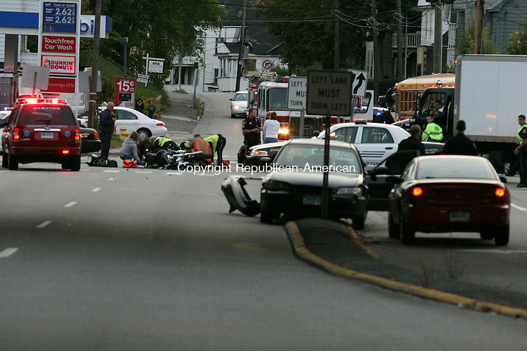 TORRINGTON, CT - 24 July, 2009 - 092609MO04 - A motorcyclist crossing East Main Street from Columbus Square toward the Route 8 south on-ramp was struck by a Honda Accord, right, traveling east on East Main Street Saturday shortly after 6 p.m. Police said the motorcyclist suffered injuries not believed to be life-threatening, and was transported to Charlotte Hungerford Hospital. The driver of the Honda was not injured. The crash closed East Main Street between Columbus Square and Christopher Road for about an hour.  Jim Moore Republican-American.