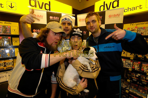 GOLDIE LOOKIN' CHAIN.Opening an HMV store in Cwmbran, Wales..December 8th, 2005.Ref: HT.half length music band group hand gesture dog animal pet.www.capitalpictures.com.sales@capitalpictures.com.©Capital Pictures