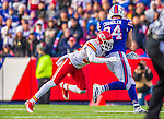 9 November 2014: Kansas City Chiefs free safety Husain Abdullah tackles Buffalo Bills tight end Scott Chandler in the fourth quarter at Ralph Wilson Stadium in Orchard Park, NY. The Chiefs rallied with two fourth quarter touchdowns to defeat the Bills 17-13. Mandatory Credit: Ed Wolfstein Photo *** RAW (NEF) Image File Available ***