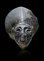 Hittite statue head of the Sun Goddess . Basalt, Hittie Period 1650 - 1450 BC. Hattusa Boğazkale. Çorum Archaeological Museum, Corum, Turkey. Against a black bacground.