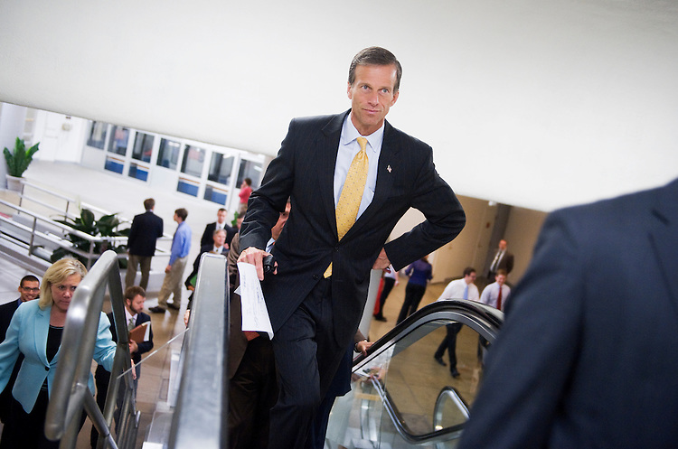 UNITED STATES - JUNE 14:  Sen. John Thune, R-S.D., makes his way through the basement of the Capitol en route to the republican senate policy luncheon.  (Photo By Tom Williams/Roll Call)