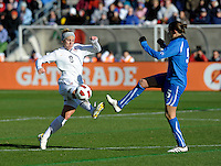 US forward Amy Rodriguez (8) battles for the ball with Italian defender Elizabetta Tona (5).  The U.S. Women's National Team defeated Italy 1-0 at Toyota Park in Bridgeview, IL on November 27, 2010 to advance to the Women's World Cup in Germany.