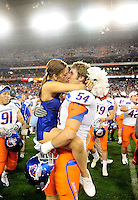 Jan. 4, 2010; Glendale, AZ, USA; Boise State Broncos offensive lineman Michael Ames kisses a cheerleader following the game against the TCU Horned Frogs in the 2010 Fiesta Bowl at University of Phoenix Stadium. Boise State defeated TCU 17-10. Mandatory Credit: Mark J. Rebilas-