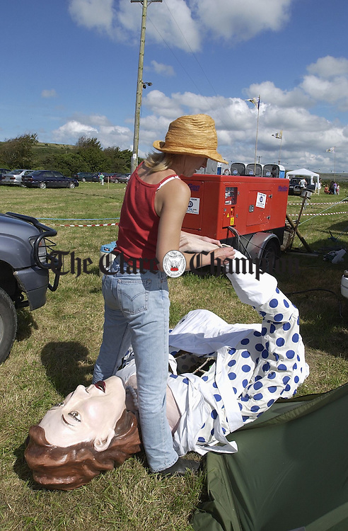 Maggie Campbell looking after one of the giant characters at the Burren Festival in Carron. Photograph by John Kelly.