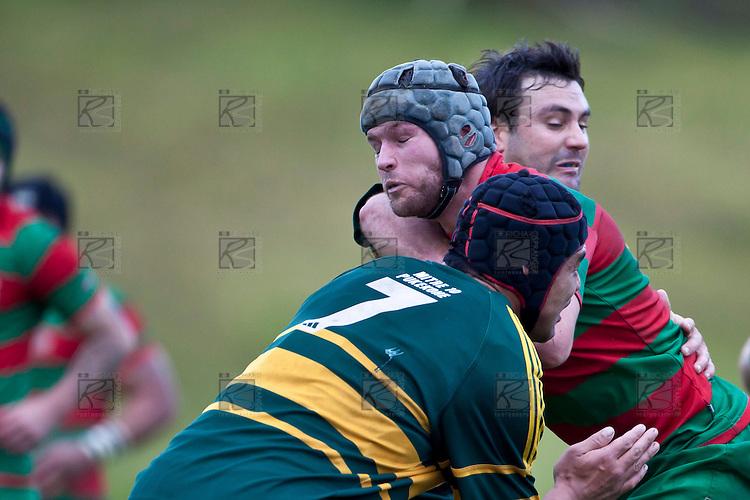 Matty Hamilton runs into the tackle of Armyn Sanders and Maama Vaipula. Counties Manukau McNamara Cup Premier Club Rugby final between Pukekohe andWaiuku, held at Bayer Growers Stadium, on Saturday July 17th. Waiuku won 25 - 20.
