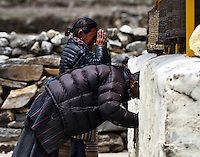 Sherpa worshippers in the village of Khumjung on the trail to Everest Base Camp in the Nepal Himalays.