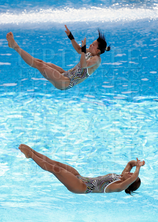Japan's Mai Nakagawa and Sayaka Shibusawa compete in the women 3-meter synchro springboard diving finals at the Swimming World Championships in Rome, 24 July 2009..UPDATE IMAGES PRESS/Riccardo De Luca