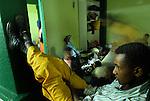 Eritrean asylum-seekers in their temporary shelter in southern Tel Aviv, Israel.