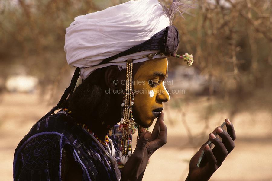 Akadaney, Niger, Africa - Fulani Wodaabe Dancer at Geerewol, preparing for Male Beauty Contest.