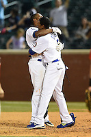 Chattanooga Lookouts first baseman O'Koyea Dickson (7) congratulated by Casio Grider (5) after a walk off base hit during a game against the Birmingham Barons on April 24, 2014 at AT&T Field in Chattanooga, Tennessee.  Chattanooga defeated Birmingham 5-4.  (Mike Janes/Four Seam Images)