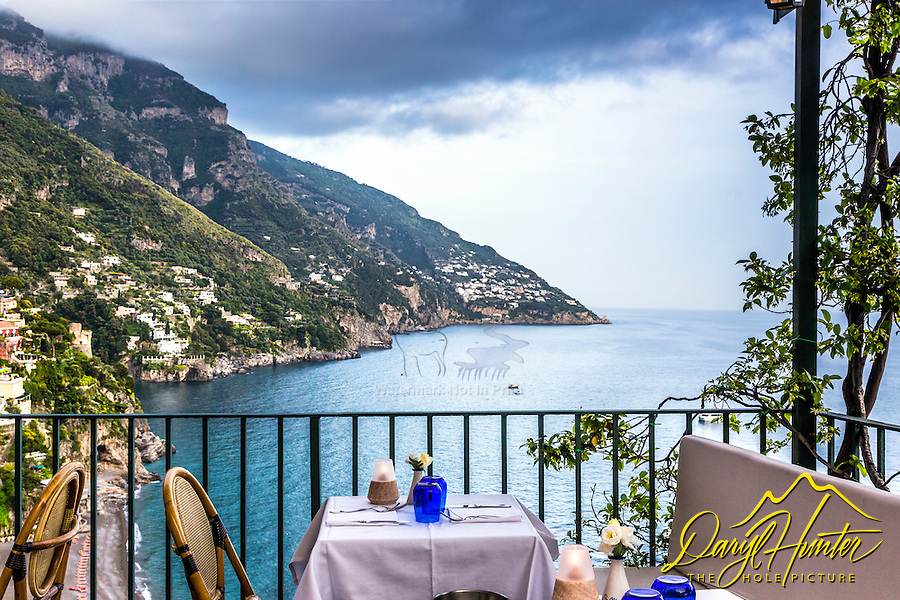 Restaurante Amalfitana, high above the tyrannian sea restaurants and hotels cling to the steep cliffs of the Amalfi Coast in Positano Italy.