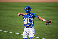 Gage Green (21) of the Ogden Raptors warms up the pitcher before the game against the Billings Mustangs in Pioneer League action at Lindquist Field on August 16, 2015 in Ogden, Utah. Billings defeated Ogden 6-3.  (Stephen Smith/Four Seam Images)