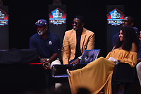 Canton, OH - August 4, 2018: Pro football Hall of Famer  Michael Irvin listens as Ray Lewis gives his induction speech at the Tom Benson Hall of Fame Stadium in Canton, Ohio August 4, 2018.  (Photo by Don Baxter/Media Images International)