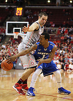 Central Connecticut State Blue Devils guard Kyle Vinales (1) passes around Ohio State Buckeyes guard Aaron Craft (4) in the second half of the college basketball game between the Ohio State Buckeyes and the Central Connecticut State Blue Devils at Value City Arena in Columbus, Saturday afternoon, December 7, 2013. The Ohio State Buckeyes defeated the Central Connecticut State Blue Devils 74 - 56. (The Columbus Dispatch / Eamon Queeney)