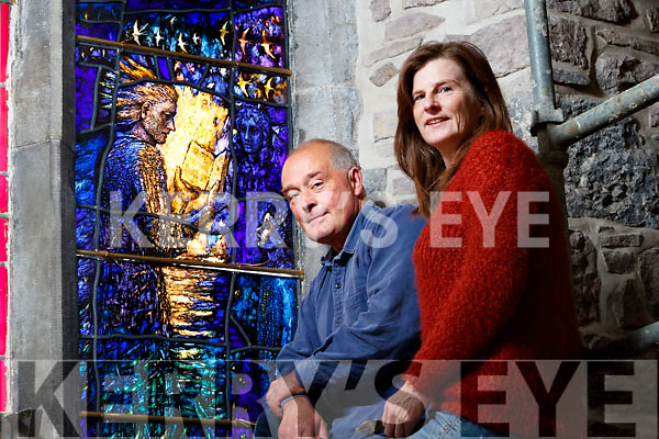 "Tom Denny and Colette Langan Installing the Stained Glass ""Reconciliation window"" in Saint Johns Church in Tralee."