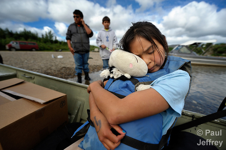 Stacey Outwater clings tightly to her stuffed animal as she gets in a boat to be taken to the yearly Tobacco Free Camp sponsored by the Nome Community Center. The camp takes place at a fishing camp near Council, Alaska, some 70 miles northeast of Nome.