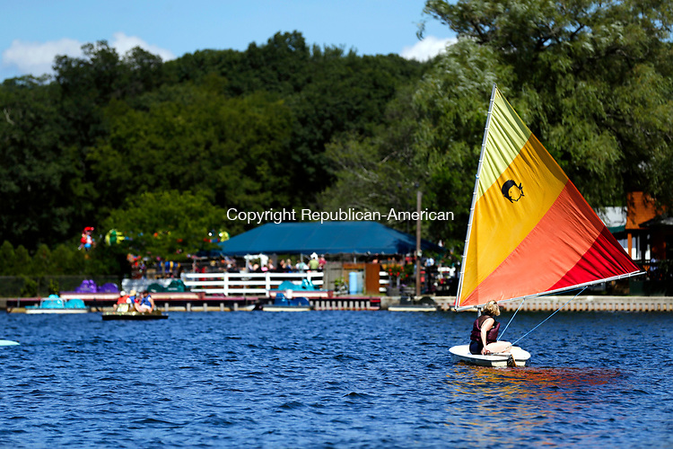 Middlebury, CT- 13 August 2017-081317CM03-   Lisa Klinefelter of Bethel, navigates the waters on Lake Quassy in Middlebury on Sunday. Clear skies and mild winds provided the sailors a pleasant afternoon on the water.   According to the National Weather Service, Monday is expected to be seasonable with highs in the lower to mid 80s.    Christopher Massa Republican-American