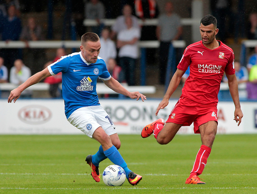 Peterborough United's Paul Taylor takes on Swindon Town's Conor Thomas<br /> <br /> Photographer David Shipman/CameraSport<br /> <br /> The EFL Sky Bet League One - Peterborough v Swindon Town - Saturday 3 September 2016 -  ABAX Stadium - Peterborough<br /> <br /> World Copyright &copy; 2016 CameraSport. All rights reserved. 43 Linden Ave. Countesthorpe. Leicester. England. LE8 5PG - Tel: +44 (0) 116 277 4147 - admin@camerasport.com - www.camerasport.com