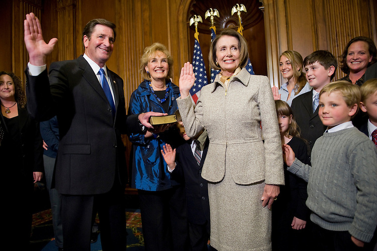 Speaker Nancy Pelosi, D-Calif. conducts a mock swearing in ceremony with Rep. John Garamendi, D-Calif., and his wife Patti and other family members, after the real swearing in on the House floor, Nov. 5, 2009.
