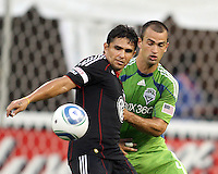 Jaime Moreno #99 of D.C. United is held by Patrick Ianni #4 of Seattle Sounders FC during an MLS match at RFK Stadium on July 15 2010, in Washington DC.Seattle won 1-0.