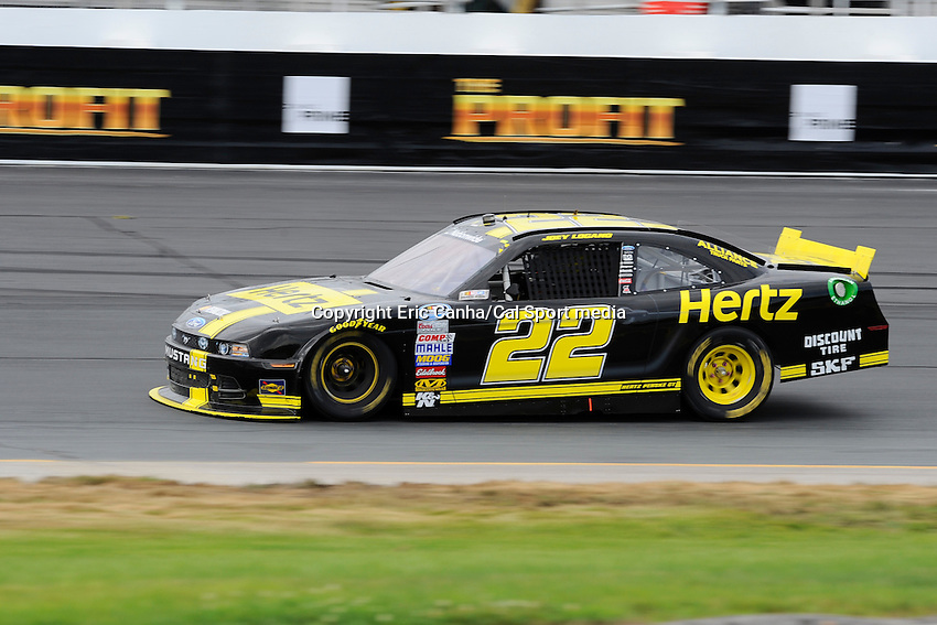 """July 13, 2013 - Loudon, New Hampshire U.S. - Nationwide Series driver Joey Logano (22)  racing in the NASCAR Nationwide Series CNBC Prime's """"The Profit"""" 200 race being held at the New Hampshire Motor Speedway in Loudon, New Hampshire.   Eric Canha/CSM"""