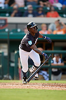 Detroit Tigers center fielder Daz Cameron (75) follows through on a swing during a Grapefruit League Spring Training game against the Atlanta Braves on March 2, 2019 at Publix Field at Joker Marchant Stadium in Lakeland, Florida.  Tigers defeated the Braves 7-4.  (Mike Janes/Four Seam Images)